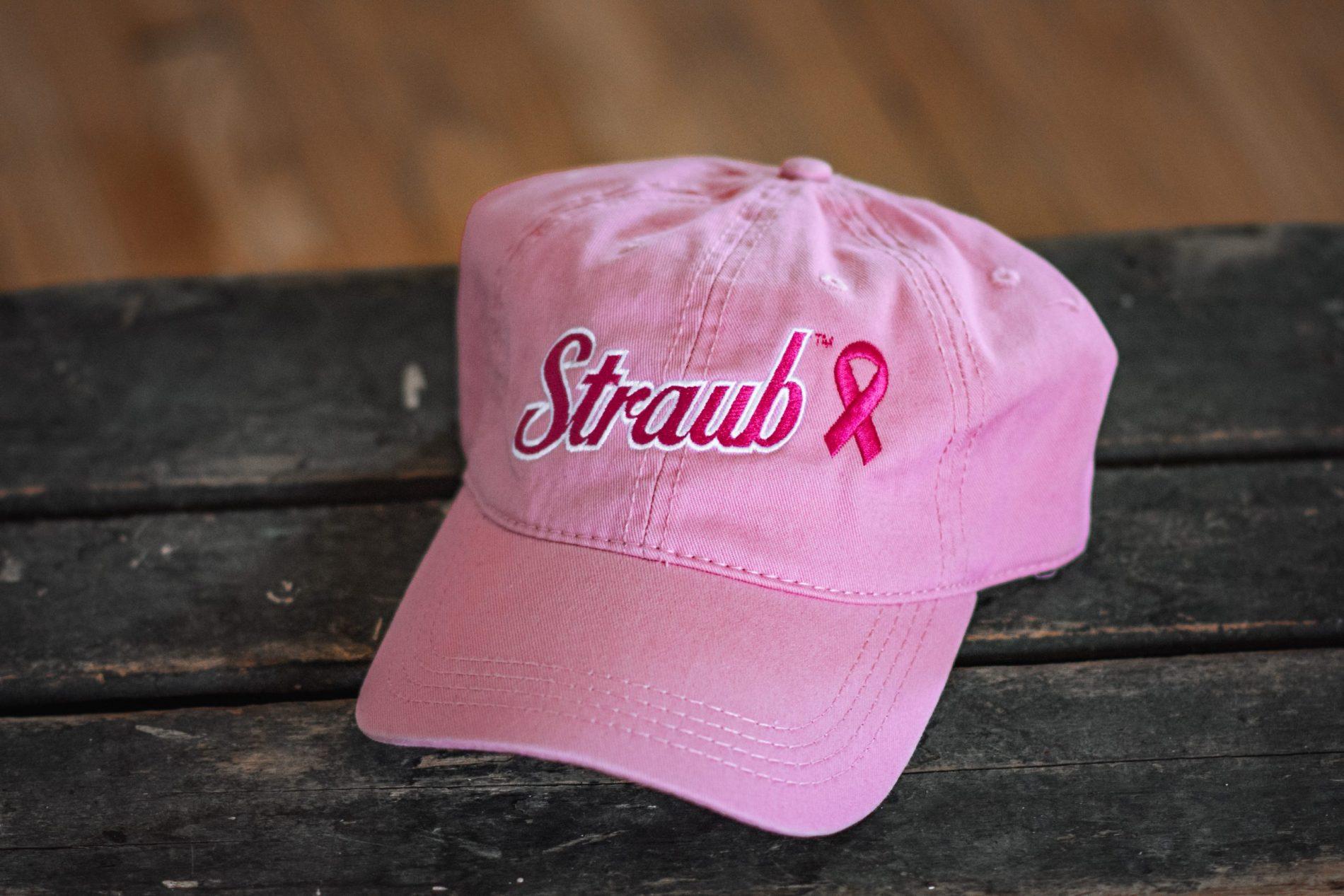 pink baseball cap with Straub logo and pink ribbon