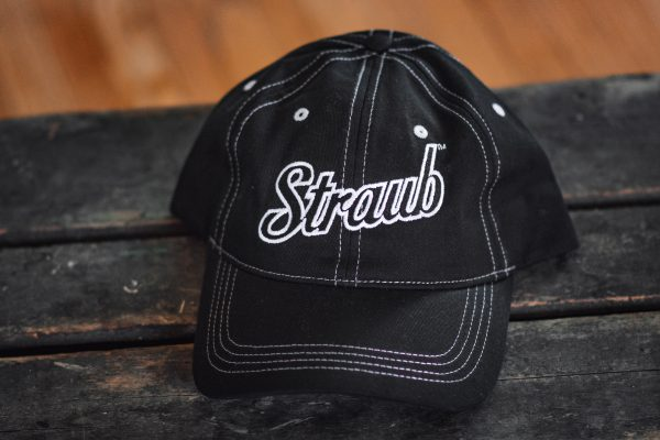Straub logo on black hat with white sewing detail