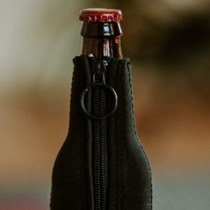 detail of zipper on Straub Brewery logo bottle koozie