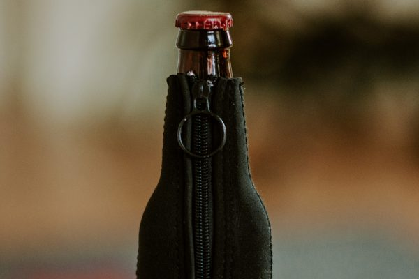 detail of zipper on Straub Brewery logo bottle koozie