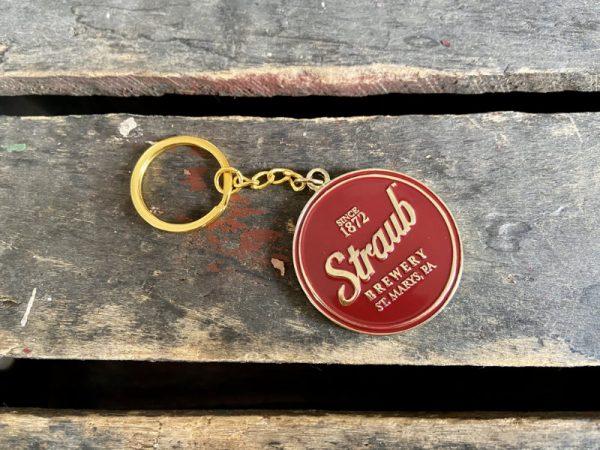 Straub gold colored enamel keychain