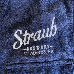 detail image of Straub Brewery logo on navy flannel shirt