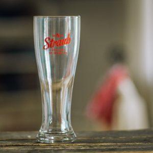 pilsner glass with Straub Brewery logo