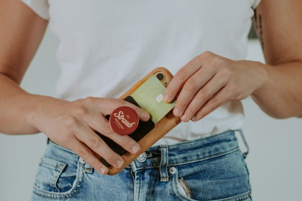 woman holding phone with Straub popsocket on it