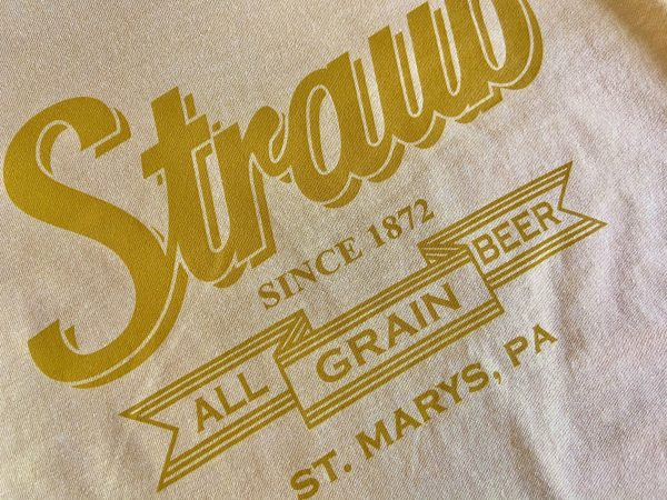 detail view of graphic on Straub long sleeve yellow tee